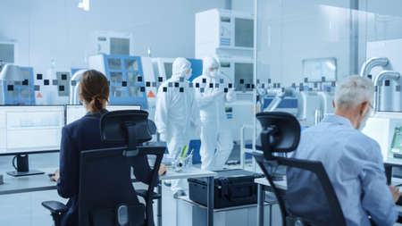 Photo pour In Clean Workshop: Professional Workers in Coveralls and Masks Use Laptop and Talk. Inside Factory Office: Female Electronics Engineer Works on Computer, Screen Shows Printed Circuit Board 3D Design - image libre de droit