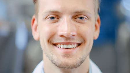 Photo for Close Up of a Handsome Young Blond Male Portrait Shot. Hes a Professional Employee. Man Looks and Smiles at Camera. Expresses Success and Happiness. He Has Blue Eyes and Light Beard. - Royalty Free Image