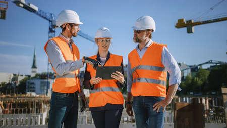Foto de Diverse Team of Specialists Use Tablet Computer on Construction Site. Real Estate Building Project with Civil Engineer, Architect, Business Investor Discussing Planning and Development Details. - Imagen libre de derechos