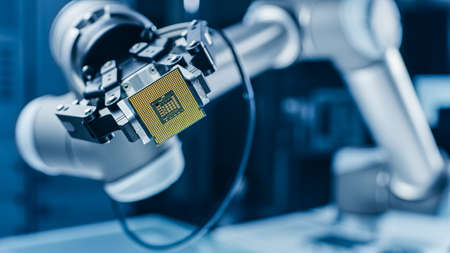 Photo pour Modern High Tech Authentic Robot Arm Holding Contemporary Super Computer Processor. Industrial Robotic Manipulator End Effector Holding CPU Chip - image libre de droit