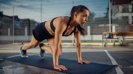 Foto für Beautiful Energetic Fitness Girl Doing Mountain Climber Exercises. She is Doing a Workout in a Fenced Outdoor Basketball Court. Evening After Rain in a Residential Neighborhood Area. - Lizenzfreies Bild