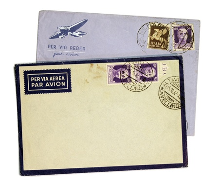 Two vintage airmail envelopes with King Victor Emmanuel III postage stamps from Italy.