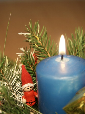 Blue candle decoration in basket of sticks
