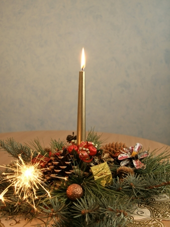 Christmas decoration with candle and sparks