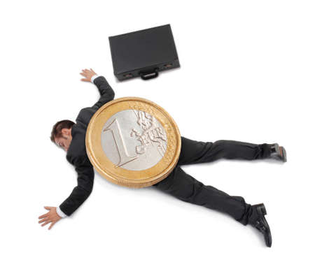 Businessman crushed by a big Euro coin