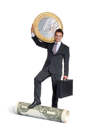 Young businessman holding an Euro coin