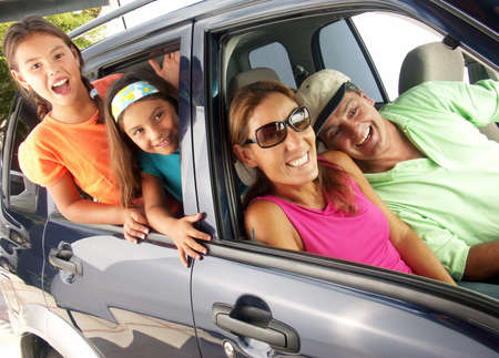 Happy family traveling on a car.