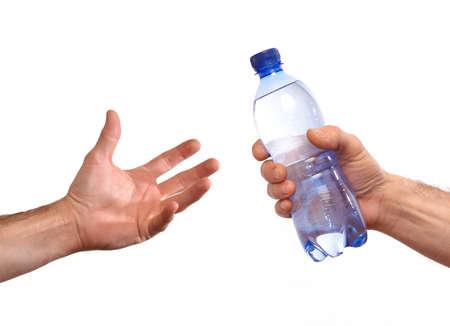 Photo pour Giving mineral water bottle - image libre de droit