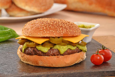 Jalapenos rustic cheese burger and avocado sauce.