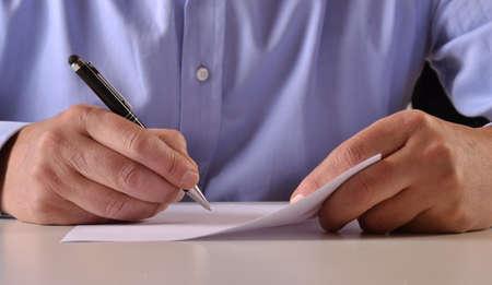 Photo pour Man hands detail writing and signing a document - image libre de droit