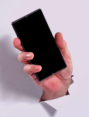 Male hand holding smartphone on white background.