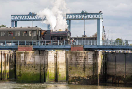 Steam Train on the bridge of a sluice St Valery sur Somme. Picardie. la France