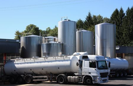 Two refrigerated tankers deliver the early morning load of fresh milk from the surrounding farms to the dairy.