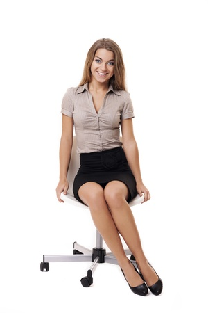 Gorgeous businesswoman sitting on a chair