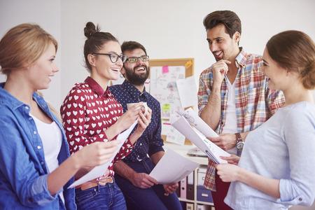 Photo pour  Happy Team leader having discussion with her team members  - image libre de droit