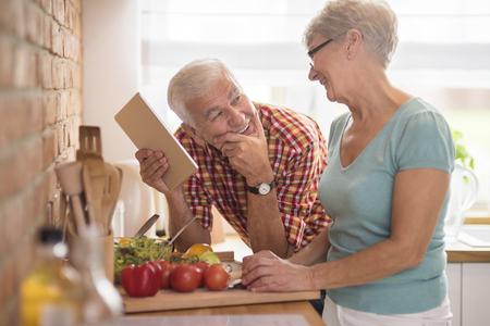 Photo pour Modern senior couple spending time in the kitchen - image libre de droit