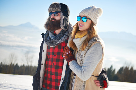 Photo for Couple walking in the snow - Royalty Free Image