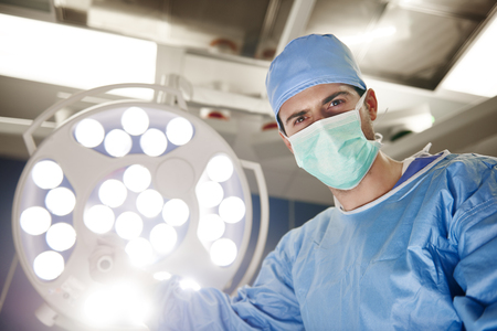 Photo for Portrait of confident surgeon in operating room - Royalty Free Image