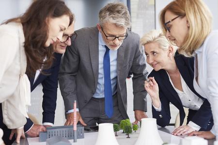 Photo pour Business leader listening attentively coworkers speech - image libre de droit