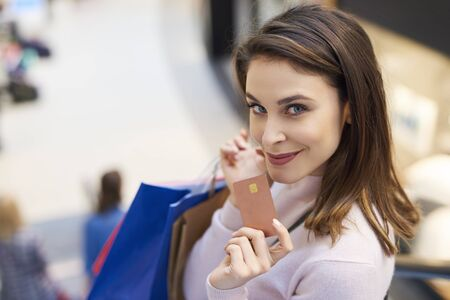 Photo pour Credit card is very necessary during the big shopping - image libre de droit
