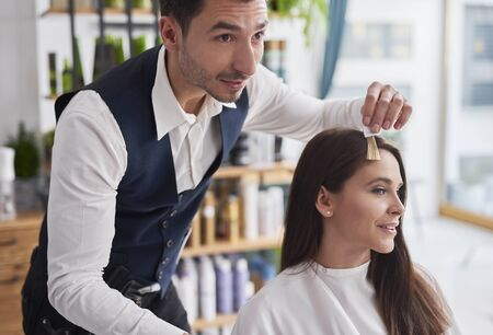 Photo pour Young woman and hairdresser choosing of color to hair dye  - image libre de droit