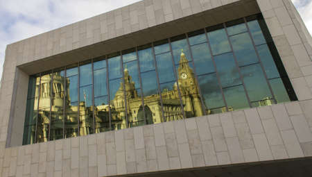 The Three Graces reflected in the Museum of Liverpool, Liverpool, England