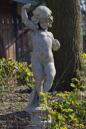 A statue of a cherub in the gardens of Stanley Park, Liverpool, England