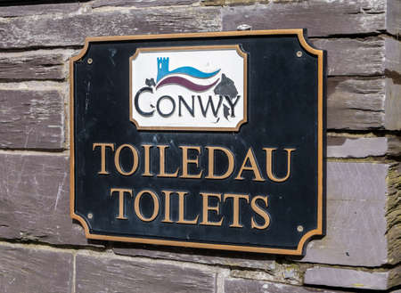 Photo for bilingual toilet sign in Betws-y-coed North Wales March 2020 - Royalty Free Image