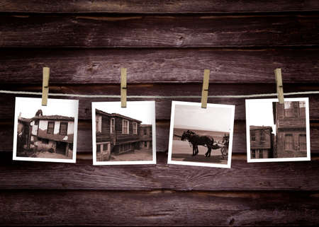 Historical turkish house photo concept.\rOld Polaroid Film Blanks Hanging on a Rope Held By Clothespins\r