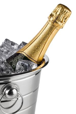 Foto de bottle of champagne in cooler with ice cubes - Imagen libre de derechos