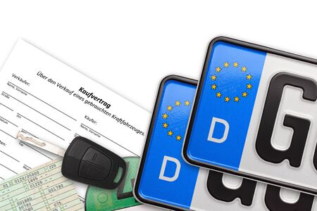 german number plates with contract key and papers on white background
