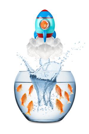 Photo pour fish leaving fish bowl with rocket - image libre de droit