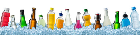 row of various beverage bottles on ice