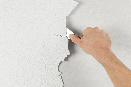 Photo pour plaster removal with hand and spatula - image libre de droit