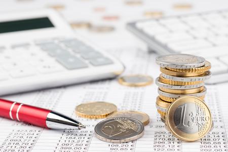 Photo pour finance business accounting stock background with stack of euro coins red pen calculator and keyboard on data sheet - image libre de droit