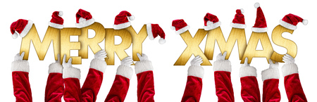 Foto de Santa hands holding up merry xmas christmas greeting golden shiny metal letters lettering with red white hats isolated wide panorama background - Imagen libre de derechos