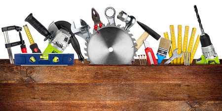 Photo for DIY tools collage concept behind wooden plank with copy space and circular saw blade isolated on white wide panorama background - Royalty Free Image