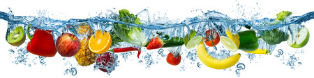 Foto de fresh multi fruits and vegetables splashing into blue clear water splash healthy food diet freshness concept isolated on white background - Imagen libre de derechos