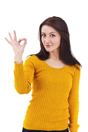Portrait of beautiful young woman gesturing a okay sign on white background