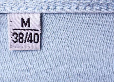 close-up of clothing label with M size