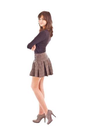 Teenage girl posing in short skirt