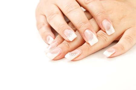 Beautiful female fingernails on white background