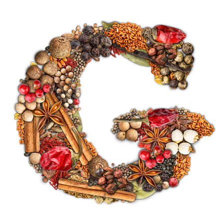 Letter G made of spices isolated on white background