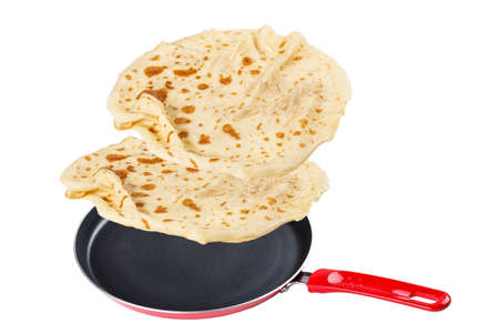 Pancake with frying pan isolated on white