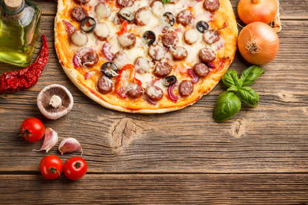Top view of pizza with ingredients