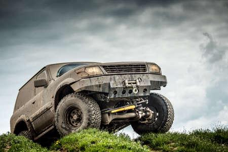 Very muddy off road car