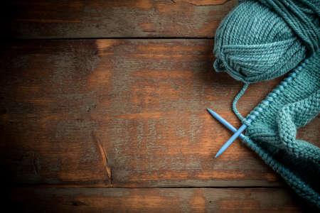 Blue knitting wool and knitting needles