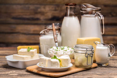 Photo pour Still life with dairy product on wooden background - image libre de droit