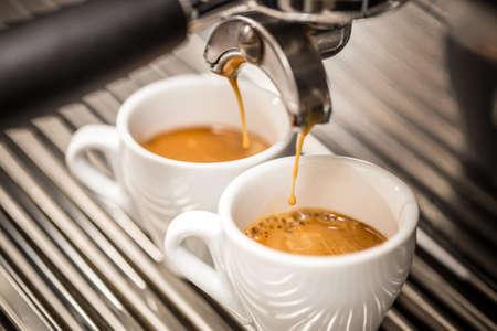 Photo pour Espresso machine pouring coffee in white cups - image libre de droit