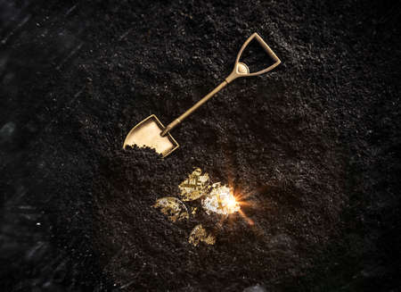 Foto de Bitcoin gold coins and shovel gardening tool. Virtual cryptocurrency mining concept. - Imagen libre de derechos